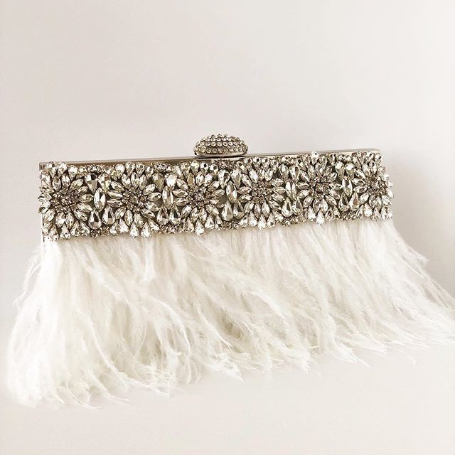 YES this clutch is gorgeous!!! If you love rhinestones and feathers then this is your statement accessory.