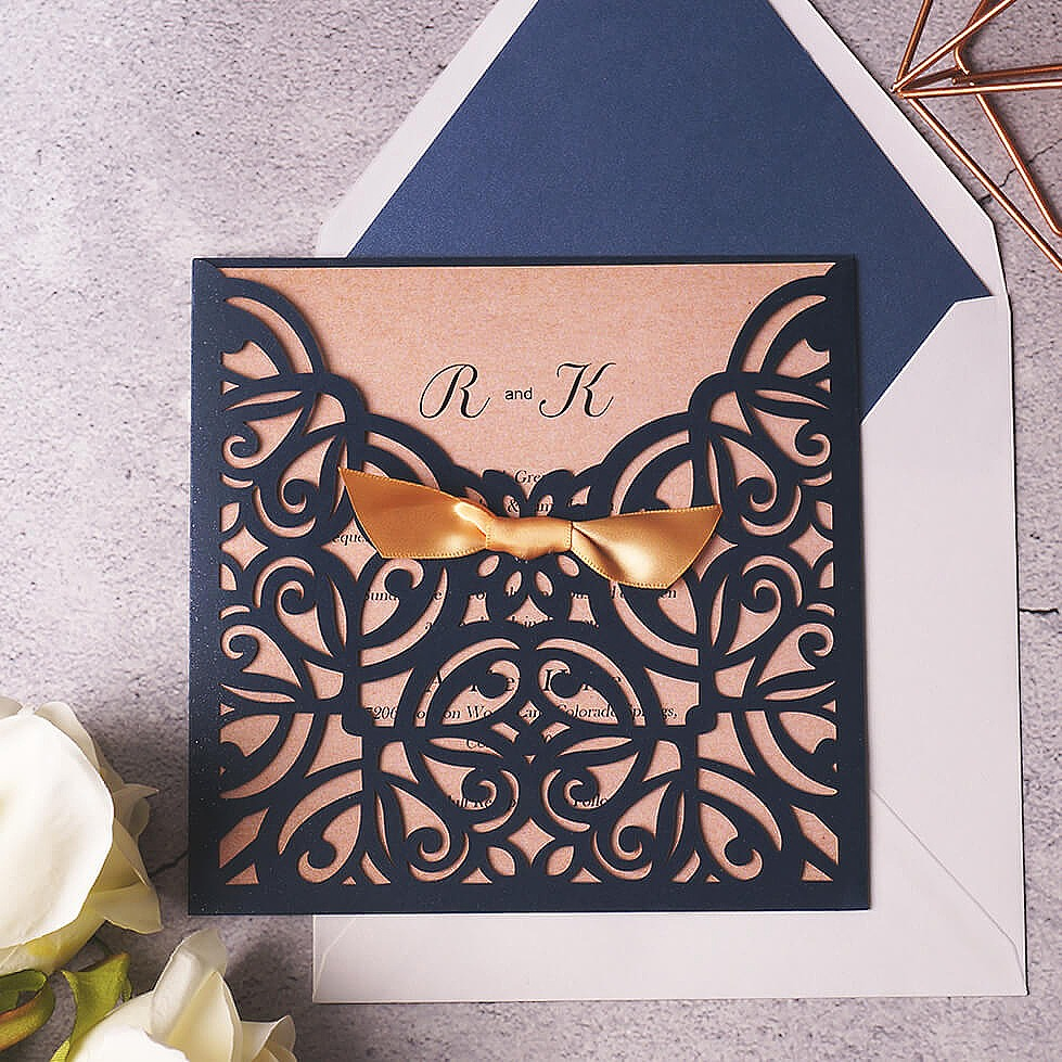The cover embraces delicate floral design cut with awful precision, with matching silky ribbon which is free of charge. This invitation