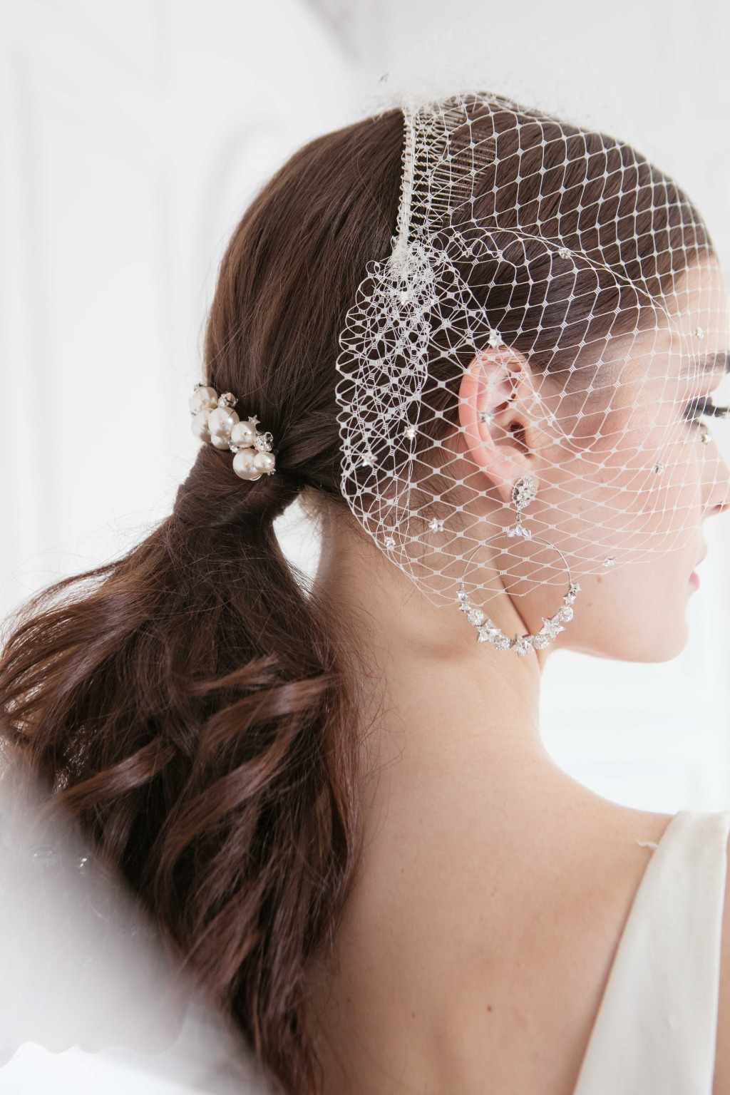 The bridal hair accessories, jewelries and face veils are all from 2020 collection.