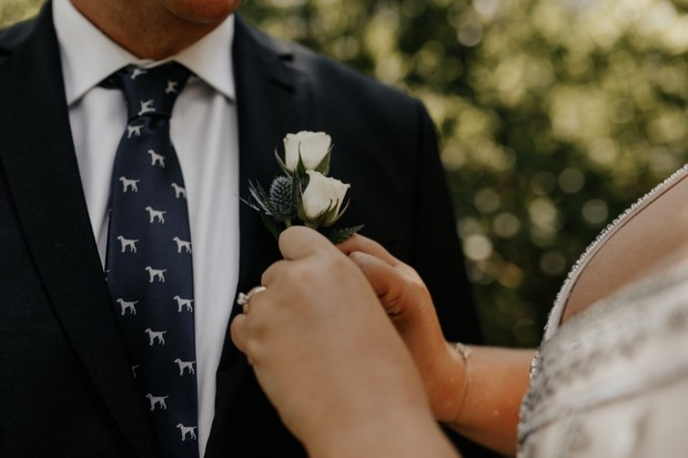 dog tie and white boutonniere