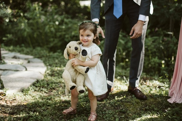 flower girl and stuffed dog toy