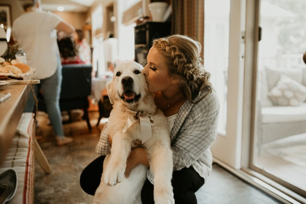 cute bride and wedding dog candid photo