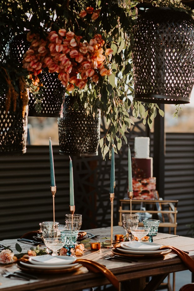 hanging lanterns over reception table