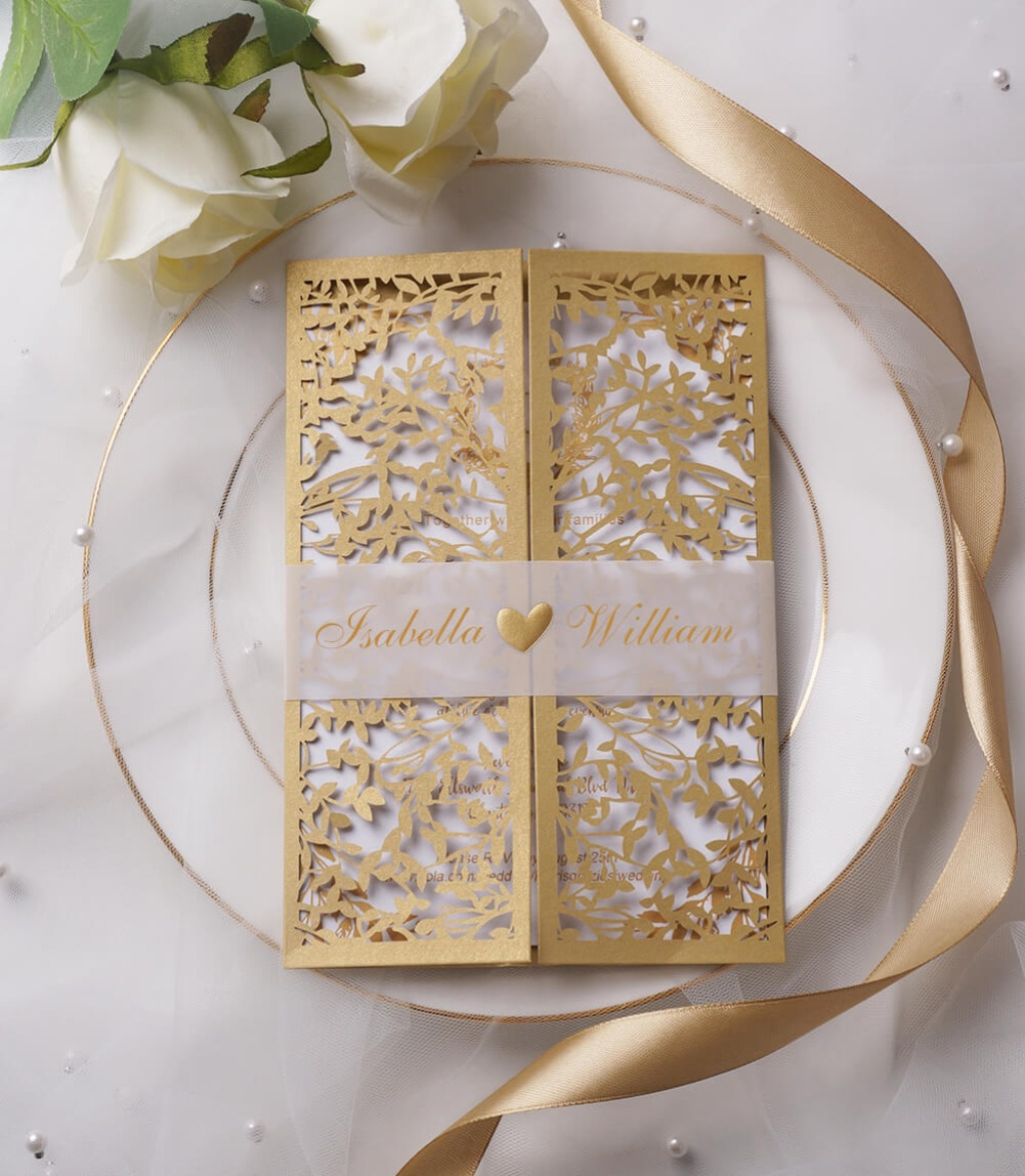 The eye-catching invite features tree-shaped laser cutting. The inside cardstock is amazingly pretty with gold design in wordings and