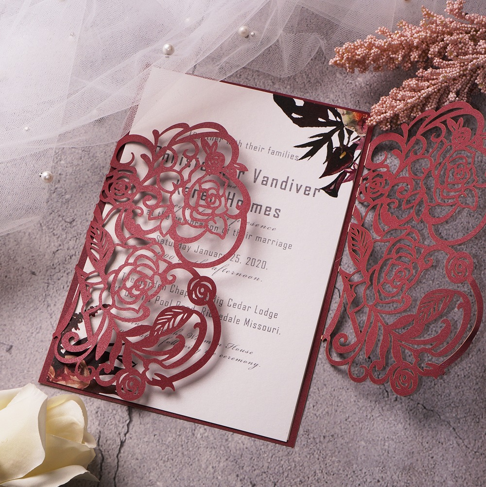 The exquisite burgundy flower pattern flows elegantly to the center of this ultra-fascinating laser-cut wedding invitation. After the