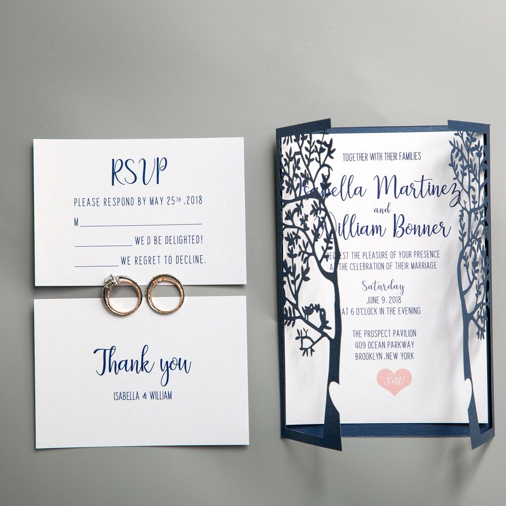 The Laser Cut wrap in Navy Shimmer hold a classically styled invitation featuring a single red rose. This invitation is finished with