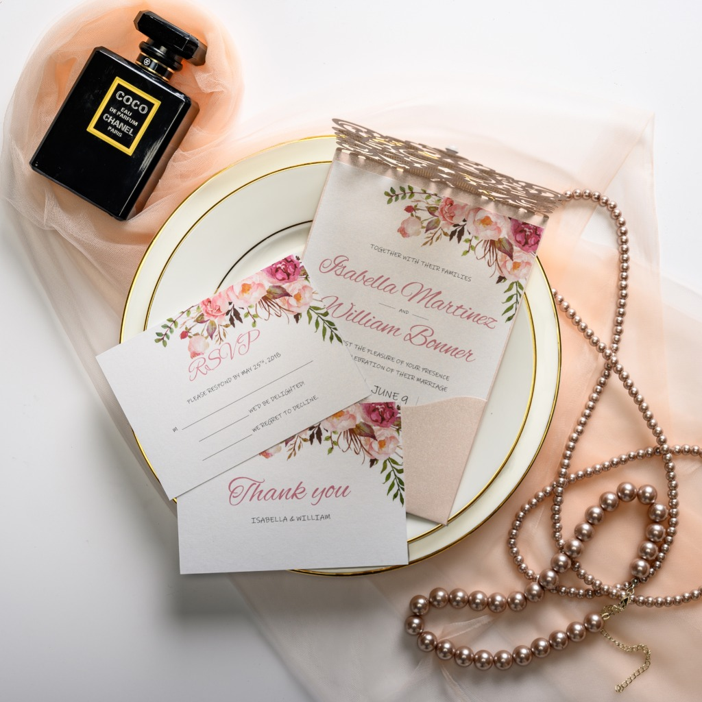 Think of this blush watercolor wedding invitation suite as a way to foreshadow an evening full of champagne toasts and bold blooms