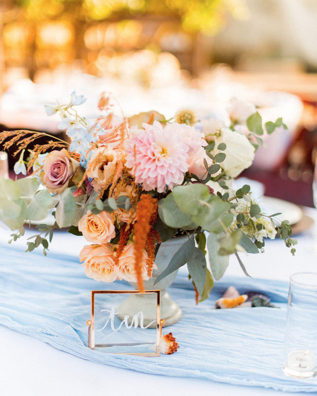 wedding table number and floral centerpiece