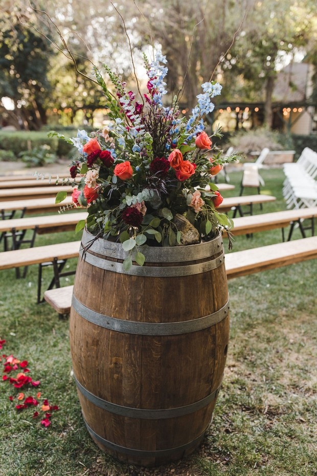 wedding floral decor and wine barrel