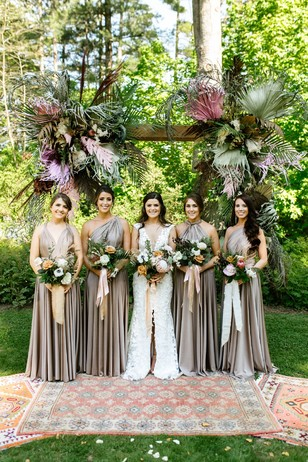 bridesmaids in deep champagne dresses