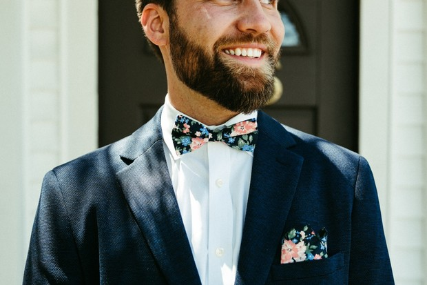 groom in navy and floral bow tie