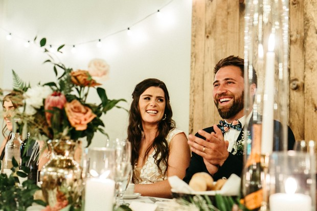 candid wedding couple at reception