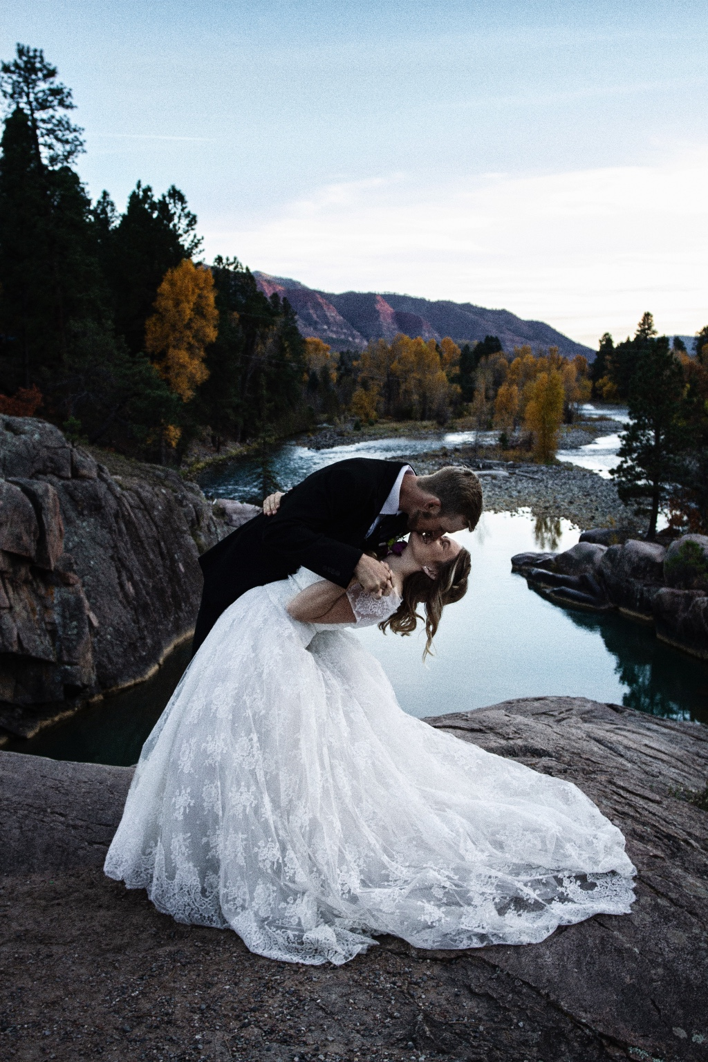 Kira and Beau, mid smile and kiss...overlooking Bakers Bridge in Durango, Colorado.