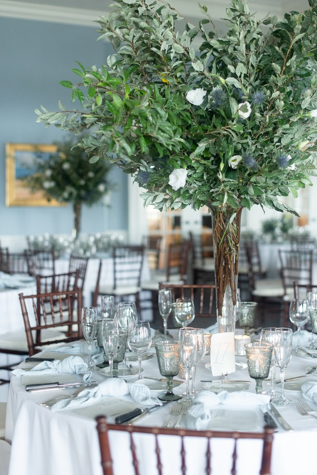tall greenery centerpiece for a wedding