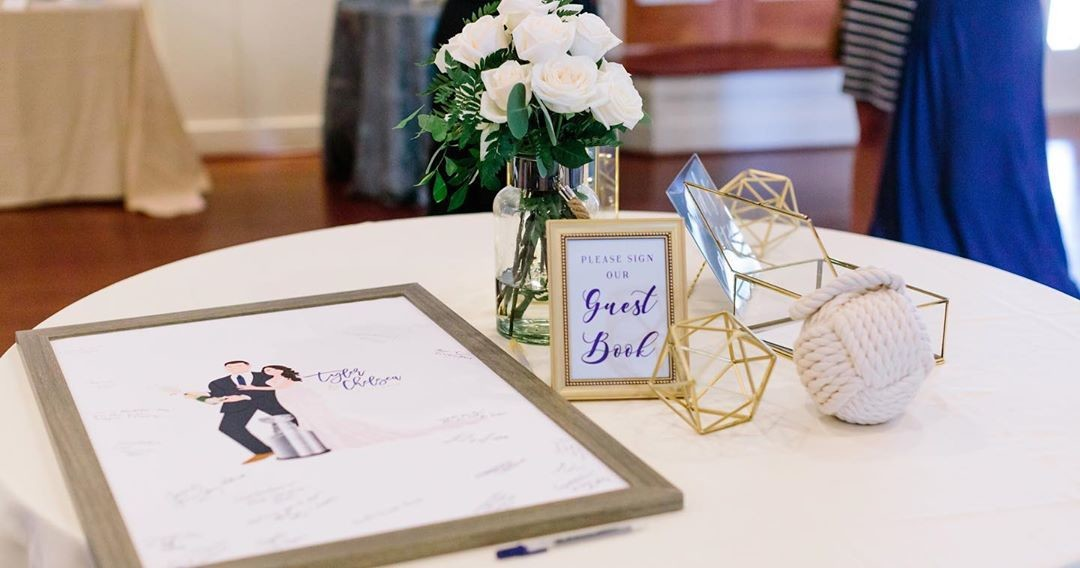 ⁠Let your guestbook have its own display table, like this couple did! The vase of roses, the sign our guestbook sign, and the wedding