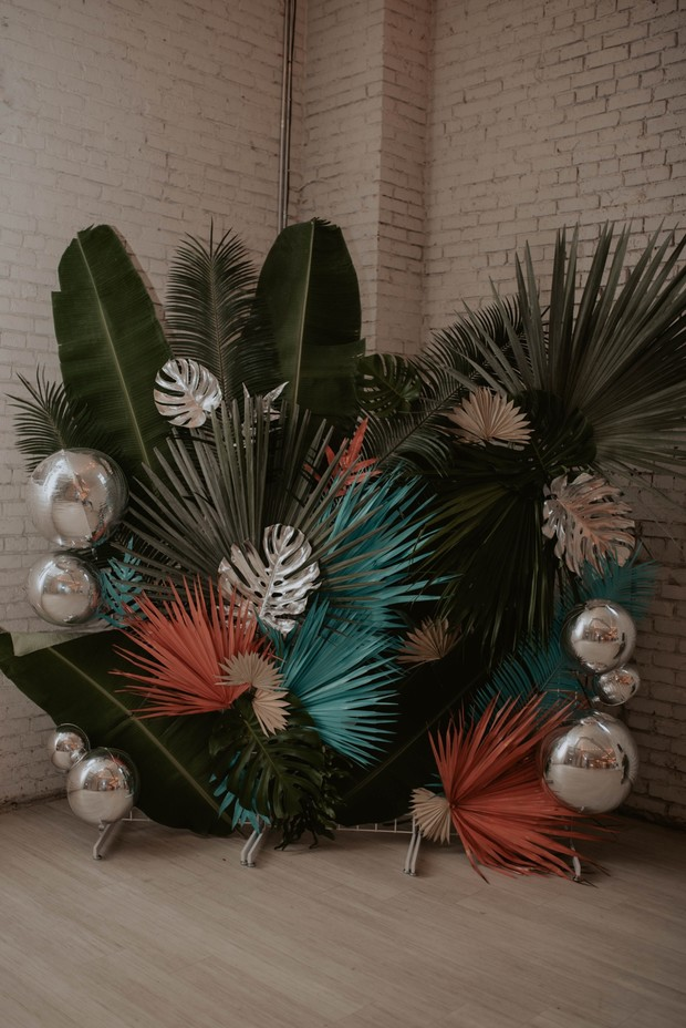 ceremony backrdrop with tropical leaves