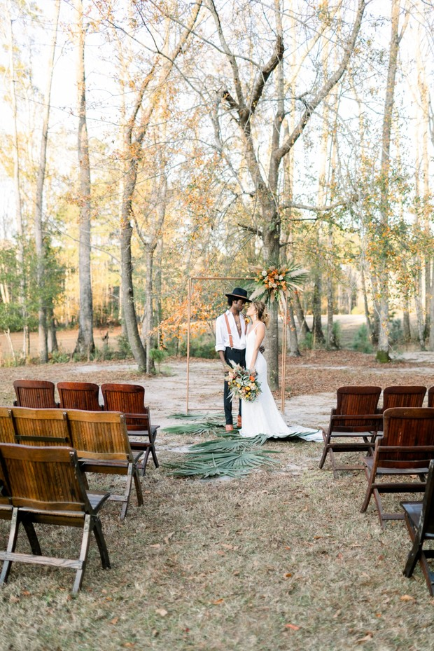 outdoor wedding ceremony with a rustic boho modern vibe