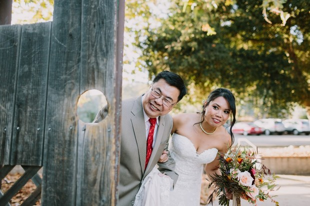 cute bride and father of the bride wedding ceremony entrance photo