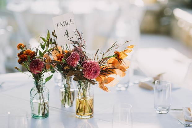 bud vases and table number centerpiece idea