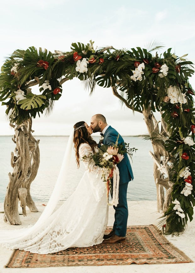driftwood and tropical floral wedding arch