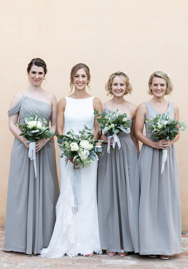bride and her bridesmaids in soft gray