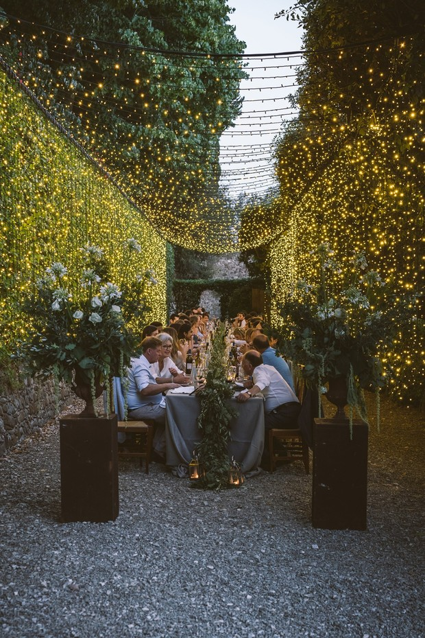 a tunnel of fairy lights wedding reception in Tuscany