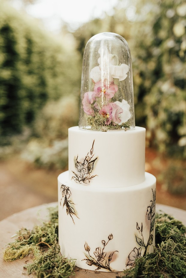 floral terrarium topped wedding cake