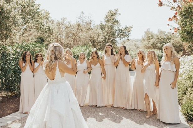 the bridal party in neutral peach dresses