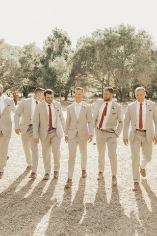 groom and his men in neutral suits