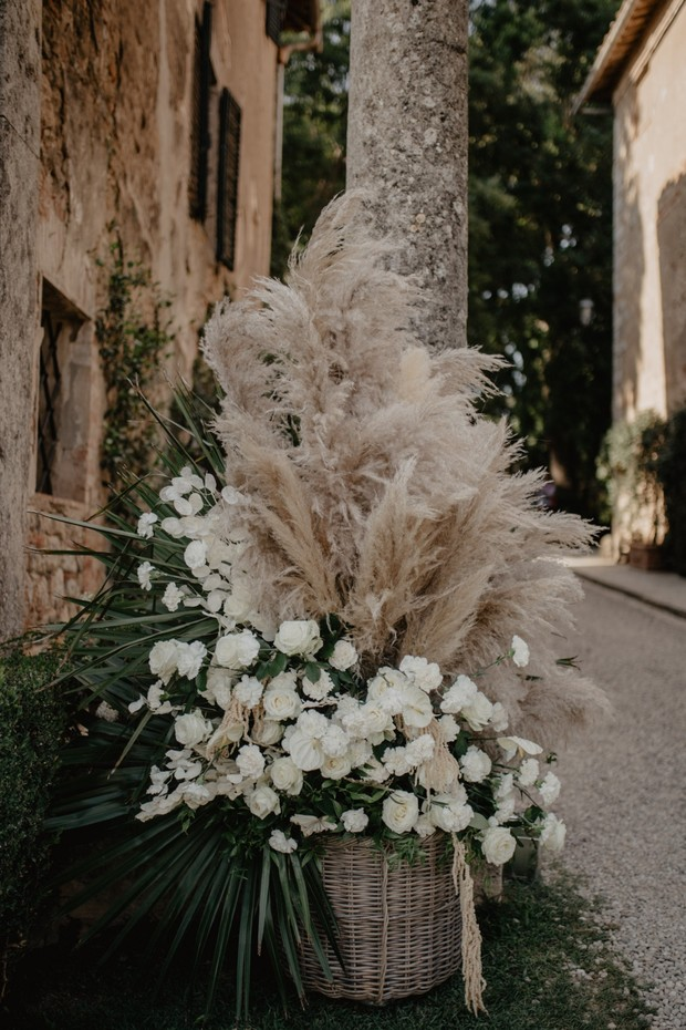 pampas grass and white floral wedding decor