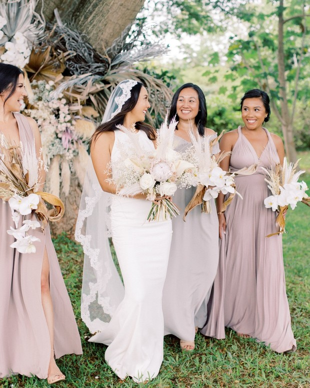 bride and bridesmaids in pretty neutral dresses