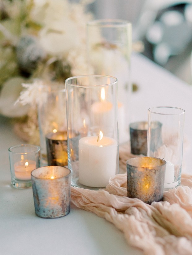 wedding reception lit by candles