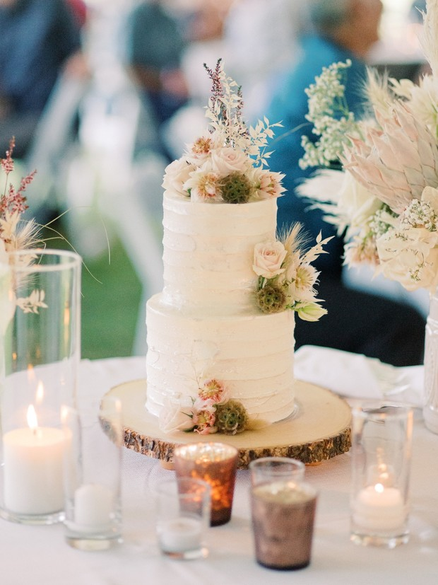 dried floral topped wedding cake
