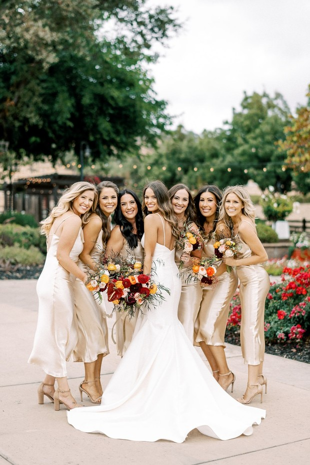 bride and her bridesmaids in gold
