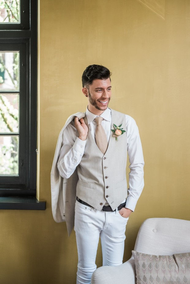 groom in white jeans