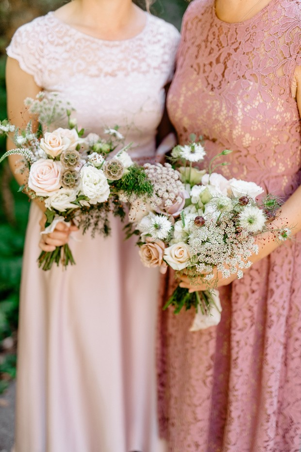 bridesmaids in pink and blush bouquets