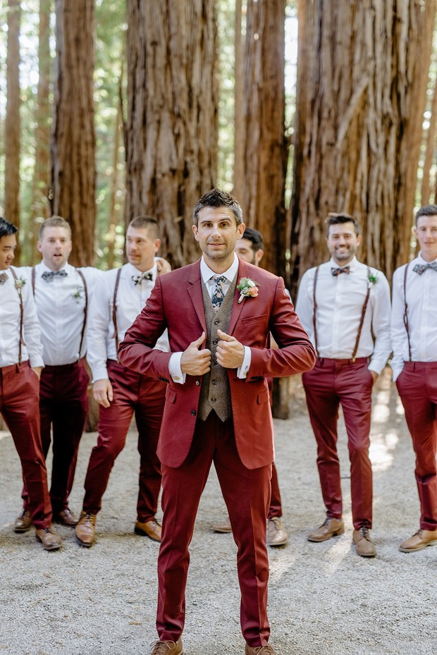 groom in wine colored suit