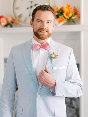 groom in baby blue suit