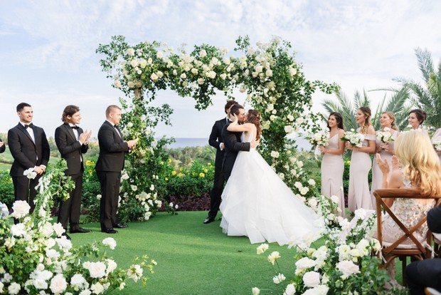 Green and white wedding ceremony
