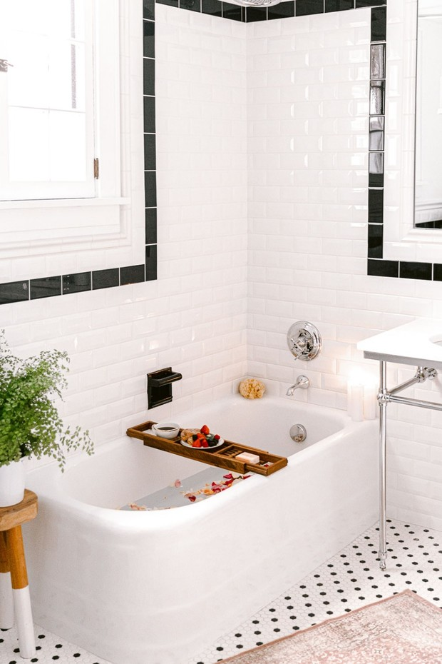 black and white bathroom with bath caddy