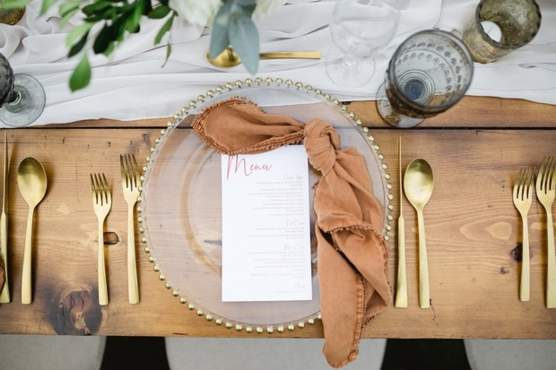 wedding place setting with gold accents
