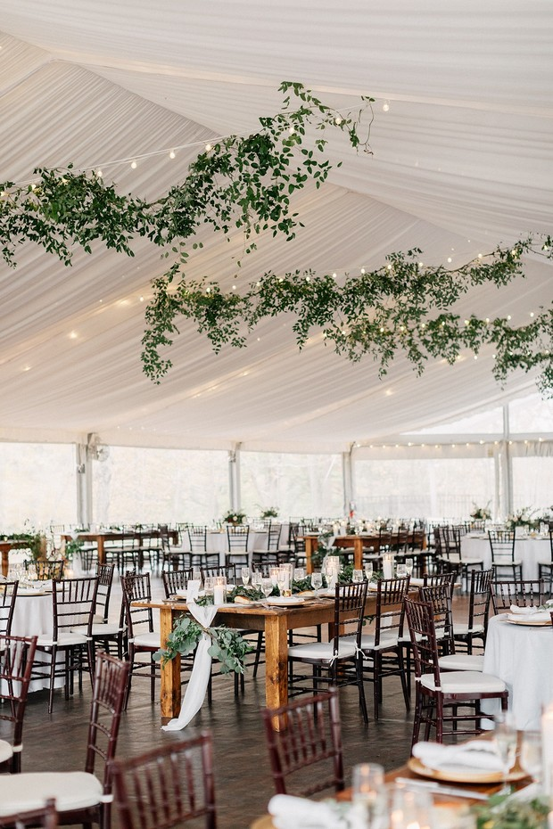hanging greenery and lighting for a wedding reception