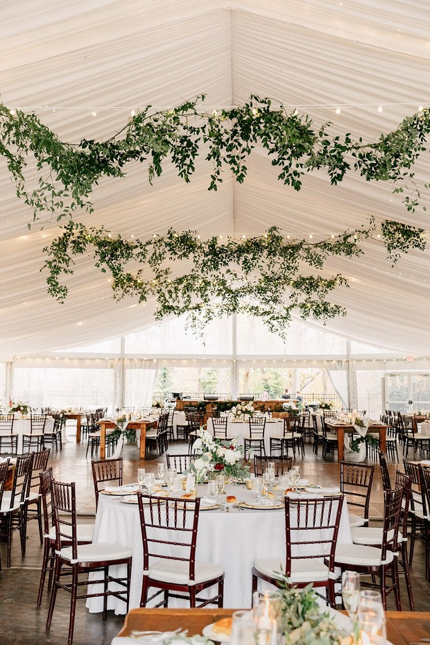 chic tent wedding venue with hanging greenery