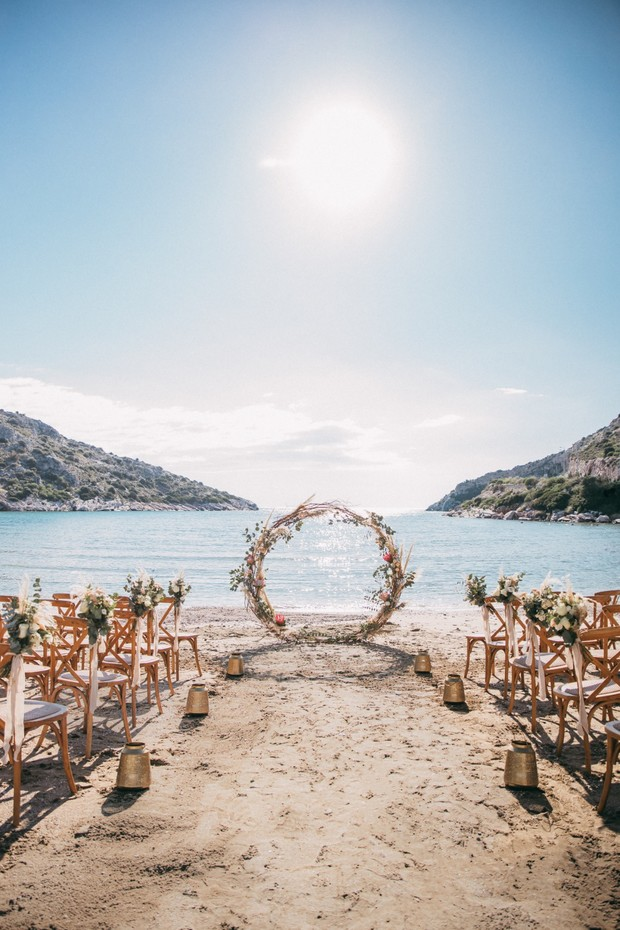 beach wedding with circle arbor