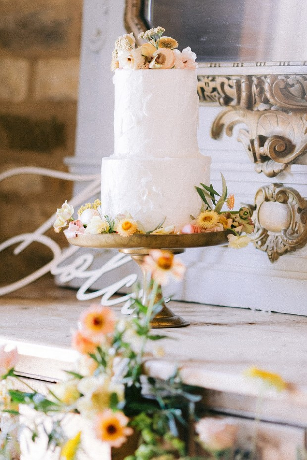 white wedding cake with flowers and macarons