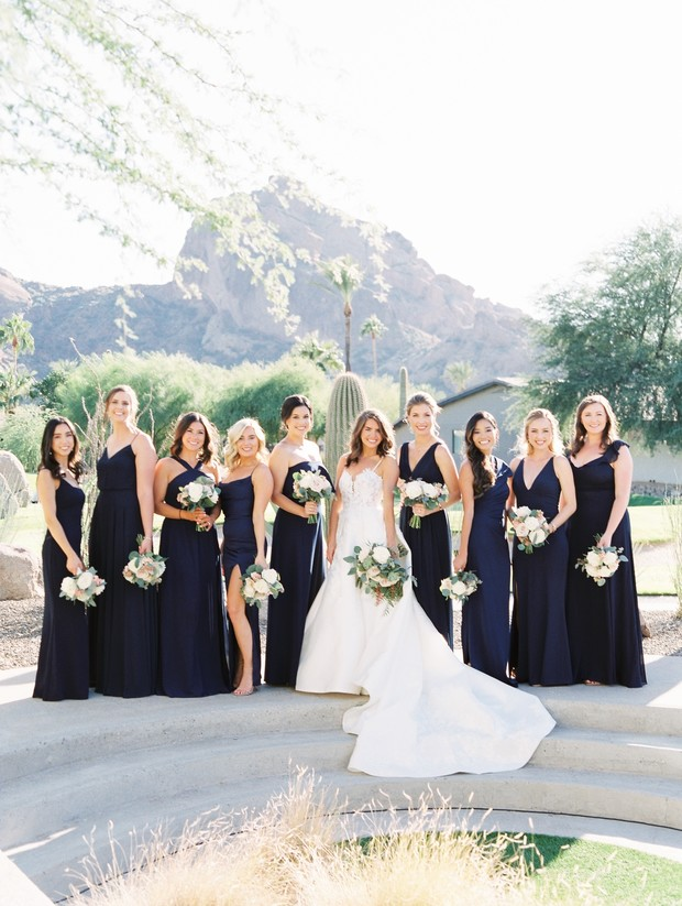 bridesmaids in navy and black dresses