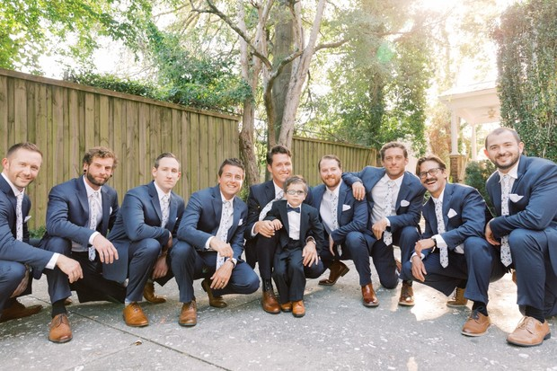 groomsmen in blue suits