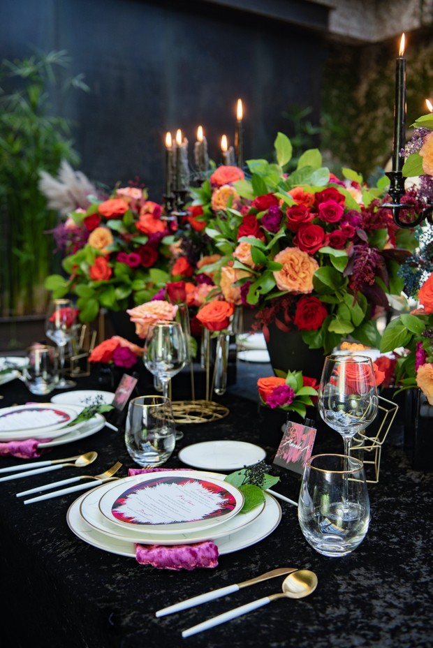 wedding tablescape in gold and black