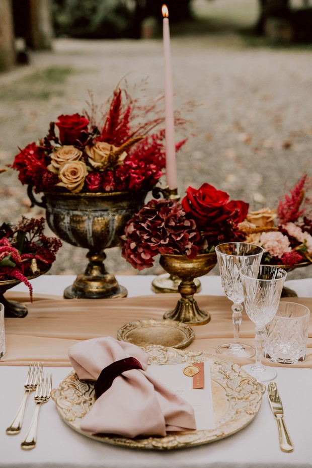 gold and red wedding reception table