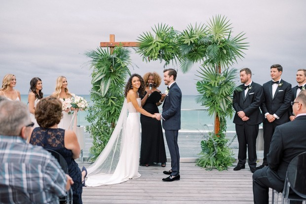 tropical greenery ceremony backdrop